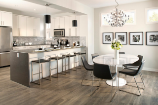 Kitchen and dining with laminate wood flooring